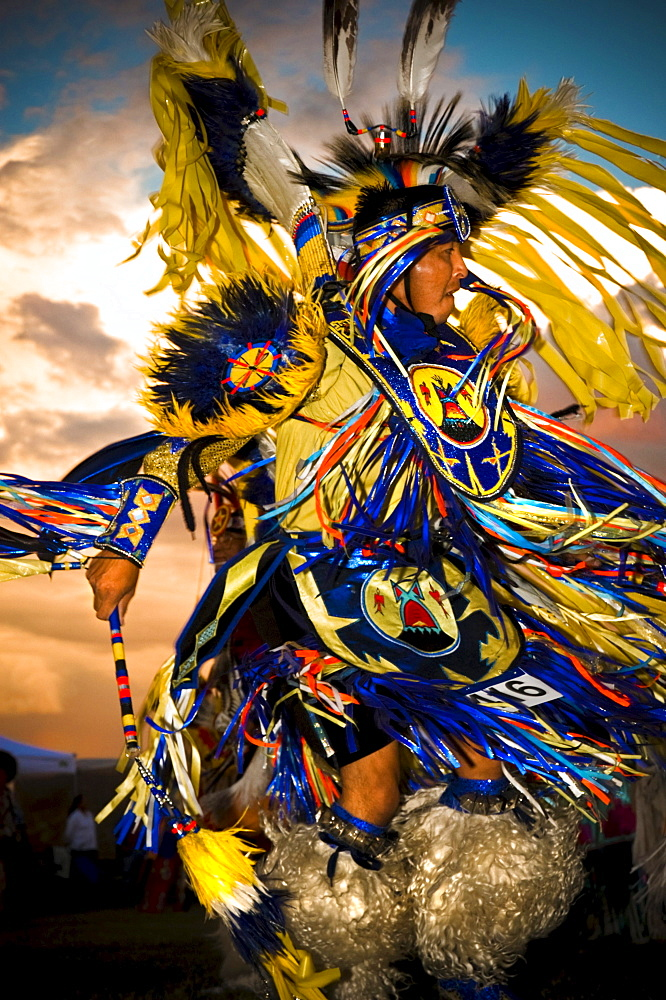 A Native American man participates in a dance at a powow in Mesa Verde, Arizona.