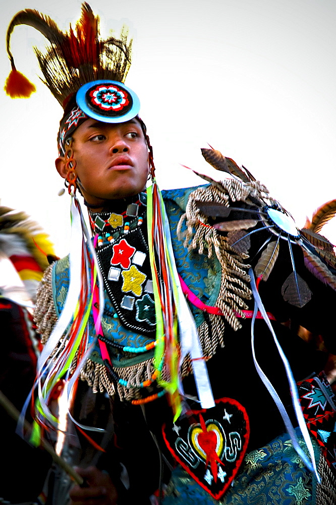 A Native American man participates in a dance at a powwow in Mesa Verde, Colorado.