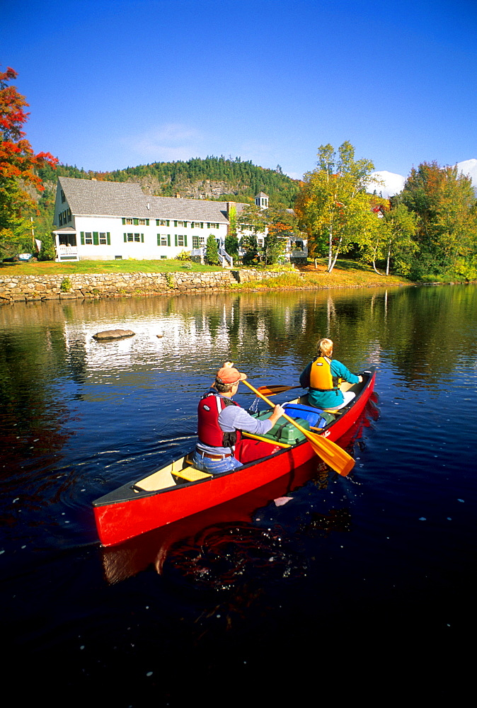 Rob Center and Kay Henry paddle their canoe on the Upper Ammonoosuc River in the village of Stark, in far northern New Hampshire. The river is a section of the Northern Forest canoe Trail, which was founded by Rob Center and Kay Henry.