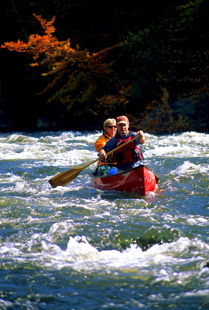 Rob Center and kay Henry paddle their canoe through whitewater on the Androscoggin River in far northern New hampshire. The river is a part of the Northern Forest Canoe Trail, which was founded by Rob and Kay.