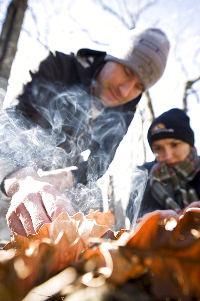 Fort Payne, AL - January 20: Greg (left) and Katy Kottkamp tend to a campfire while climbing near Fort Payne, Alabama.
