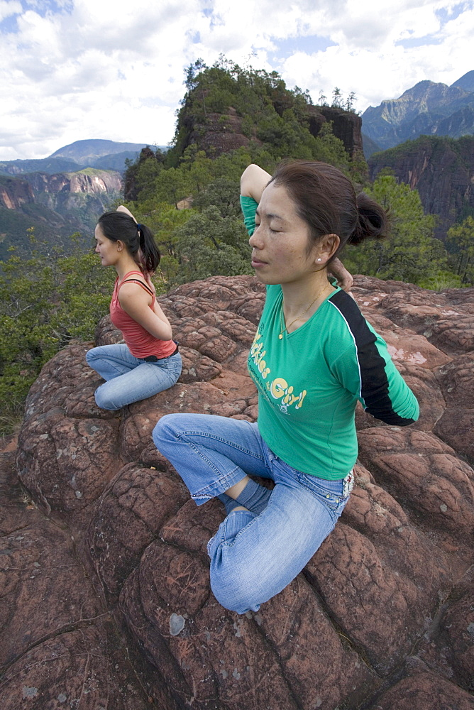 Hikers practice yoga on top of Thousand Turtle Mountain in the Laojun Mountain Nature Reserve north of Lijiang, Yunnan Province, China.
