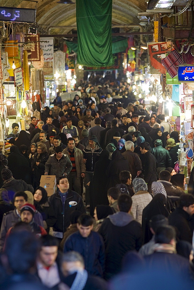 Tehran, Iran - February, 2008: Crowds of shoppers inside the busy Tehran Bazaar in the south of the city.