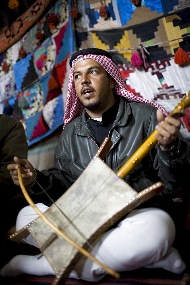 Palmyra, Syria - January, 2008: Bedouin man playing a traditional instrument.