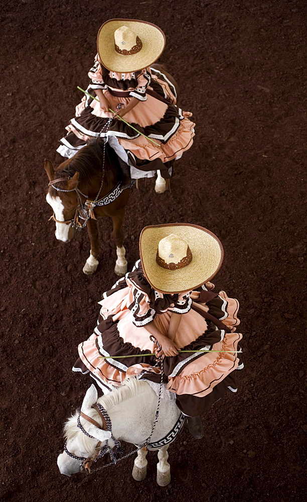 "Escaramuza from Anahuac of Tecamac team ride their horses in a rodeo competition in Chalco on the outskirts of Mexico City, May 10, 2008. Escaramuzas are similar to US rodeos, where female competitors called ""Amazonas"" wear long skirts, and ride side sadd"