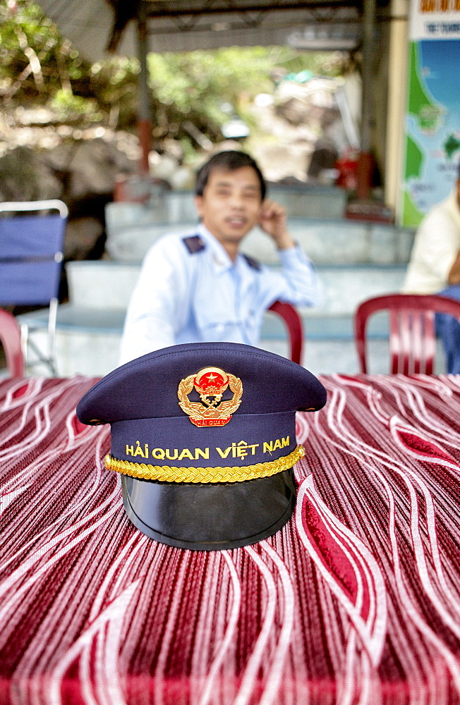 Vietnamese custom officer waiting for new arrival in the Nha Trang harbor, Vietnam.