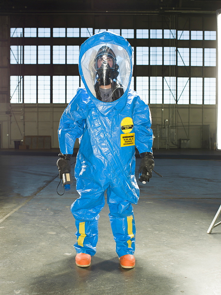 A National Guardsman wears a Nuclear radiation suit during training at an air base in South Dakota.