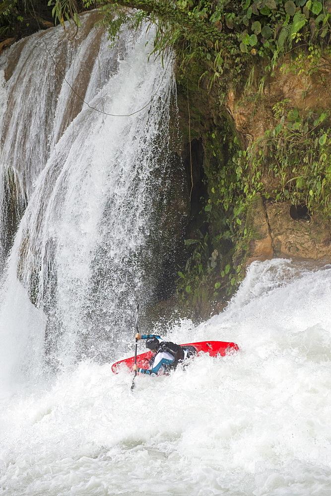 One kayaker descending a white water river at Cascadas de Agua Azul, Chiapas, Mexico.
