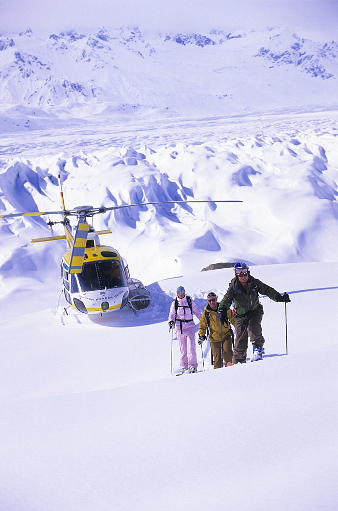 Skiers and helicopter in Tordrillo Mountains, Alaska, United States of America