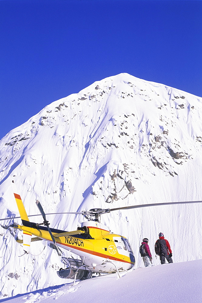 Ingrid Backstrom and Shane McConkey scoping a line in Haines, Alaska, United States of America