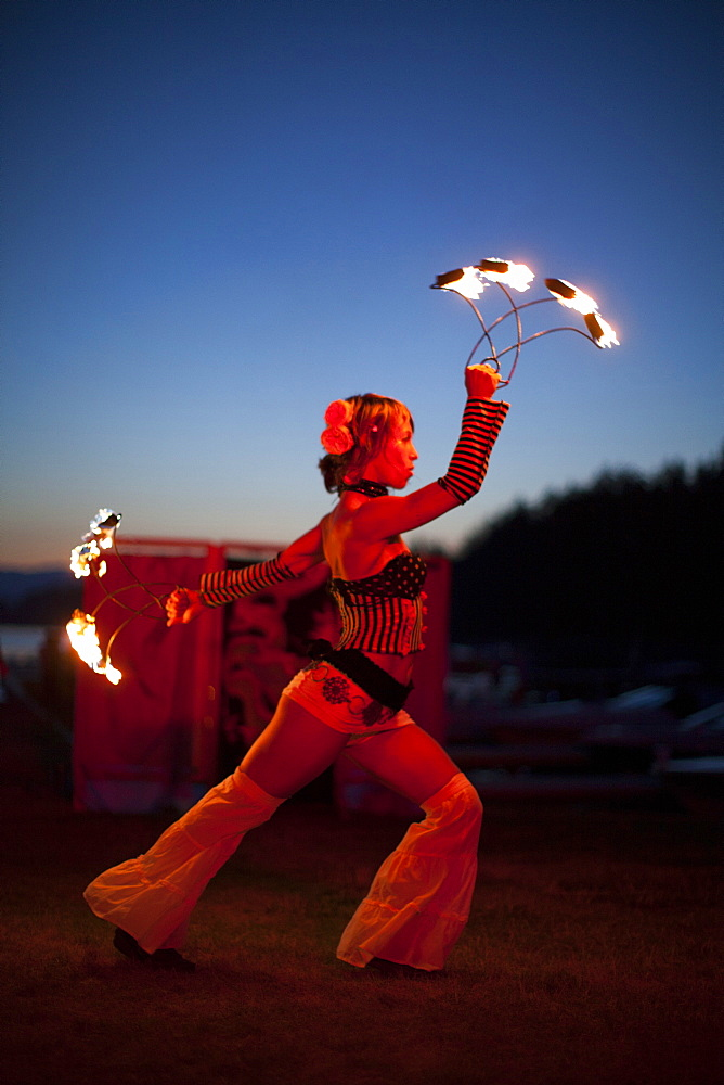 A fire dancer performing outdoors.