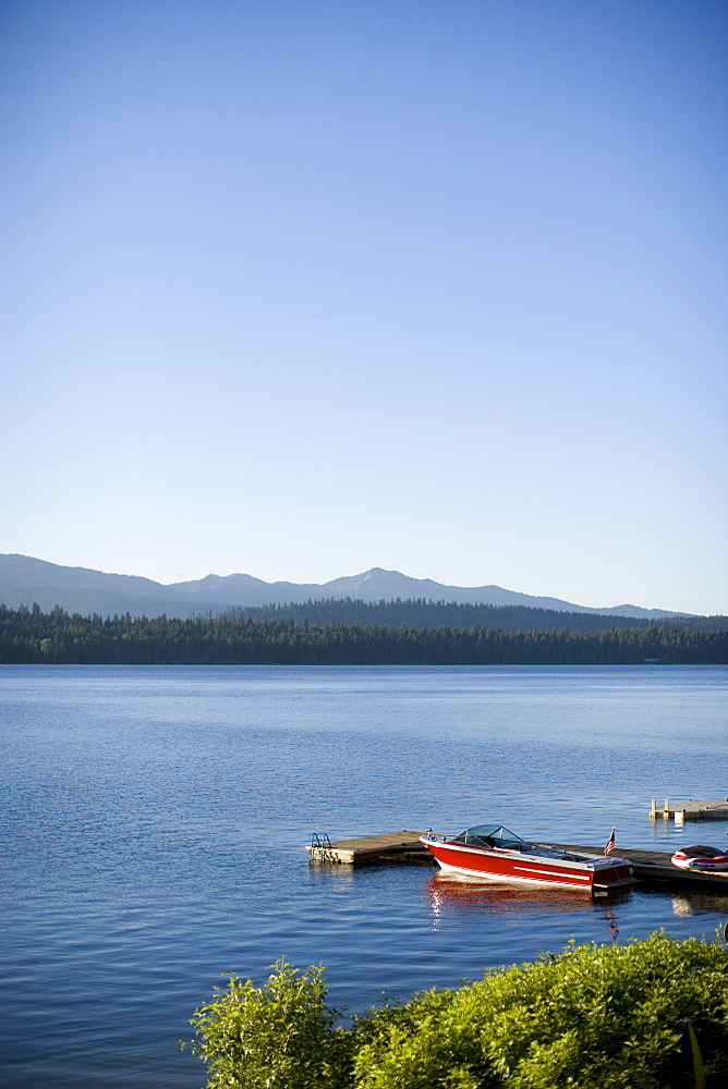 Scenic image lake with boat in foreground.