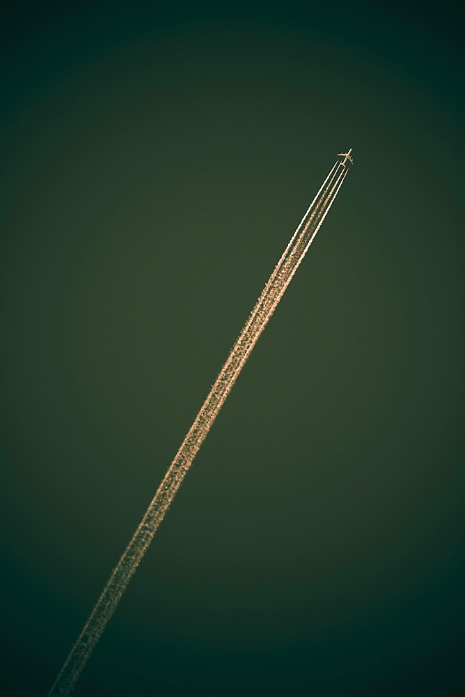 Jet contrail against green sky. Quebec, Canada.