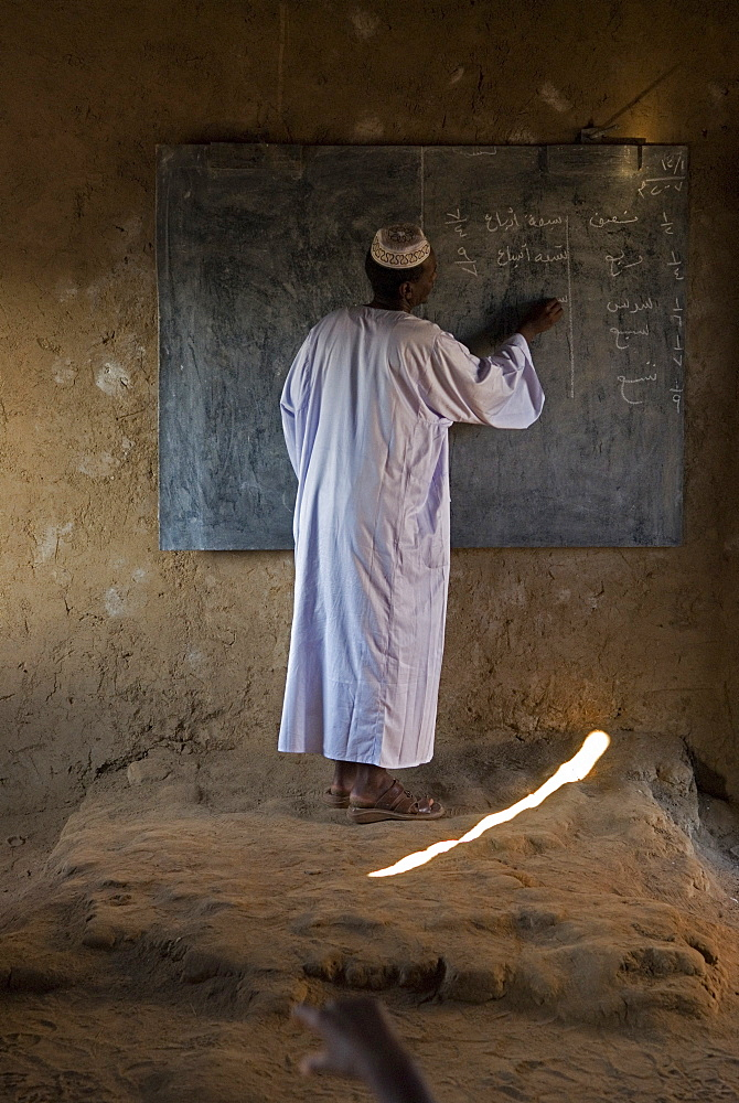 A teacher in a classroom in primary school in El-Ar, northern Sudan.