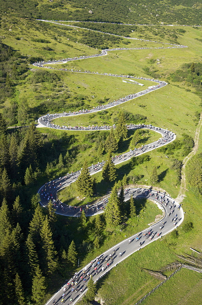 Aerial view of the road up to Passo Pordoi (2239 m), the second pass of the Maratona dles Dolomites bikerace. The race is held o