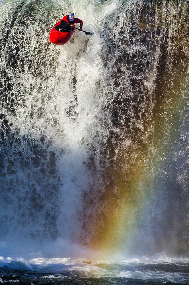 "Spanish whitewater kayaker drops down the 40-foot ""Tobalina Falls"" in Pedrosa de Tobalina, Spain."