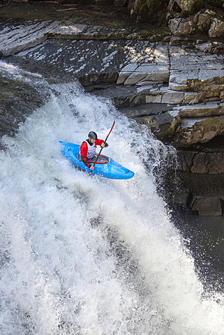 Kayak racing on the New Haven River at Bartlett Falls in Bristol, Vermont.