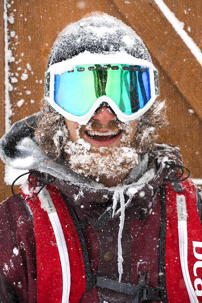Portrait Of Happy Male Snowboarder During Snow