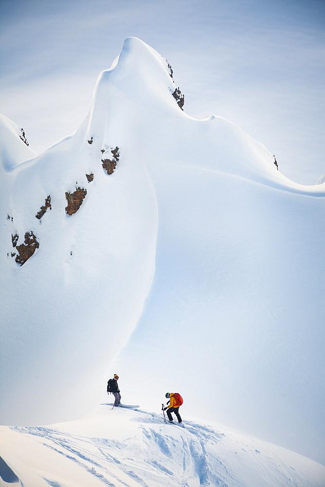 Two Skiers Preparing To Ski On Gargoyles Near Elfin Lakes In Garibaldi Provincial Park, Canada