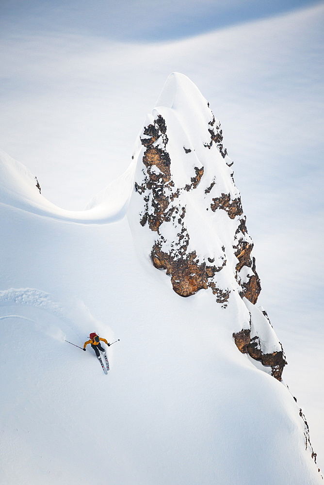 Person Skiing On Snowy Slope Near Elfin Lakes In Garibaldi Provincial Park, Canada