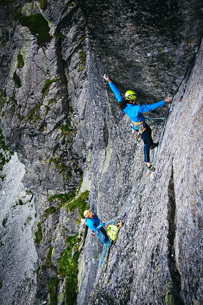 Climbers On Multi Pitch Route In Mountains Of Tatra National Park, Poland