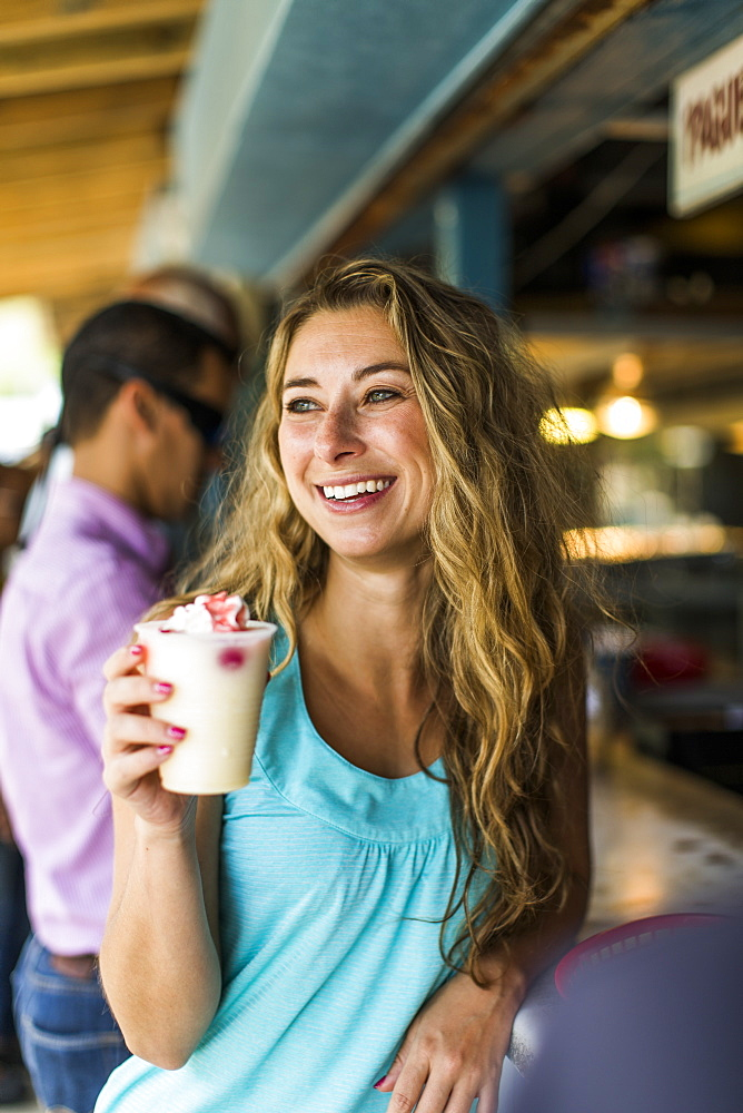 Portrait Of A Woman Enjoying A Pina Colada In Puerto Rico
