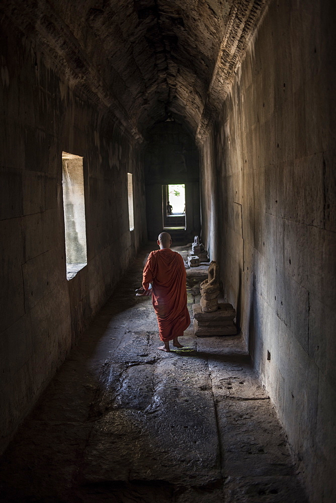Young Buddhist Monk Walking At The Angkor Wat Temple, Siem Reap, Cambodia