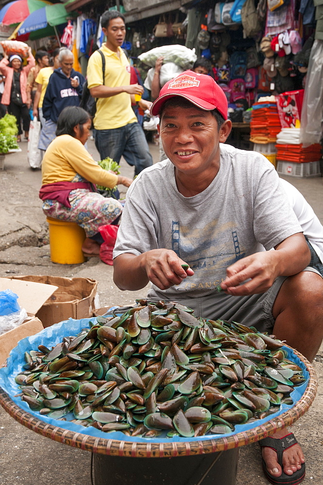 Man Selling Seafood In Street Market At Baguio, Philippines