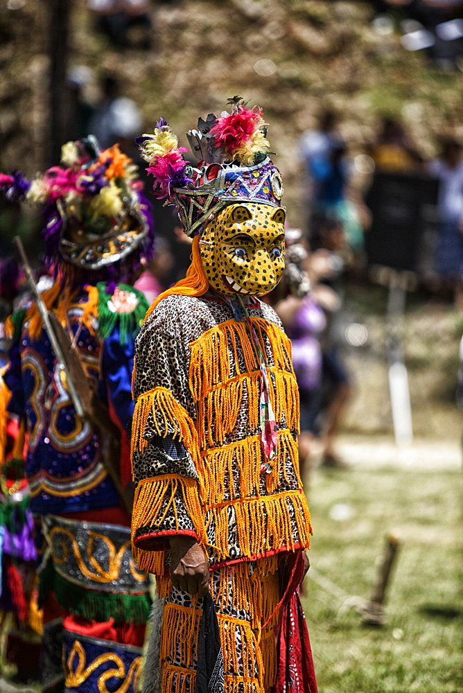A Mayan Jaguar dancer performs at a cultural ceremony at Blue Creek Village, Toledo, Belize