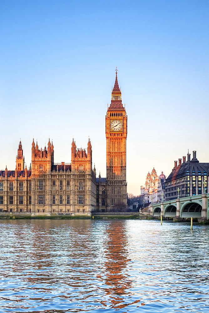 Palace of Westminster and Big Ben across Thames River, London, England, UK