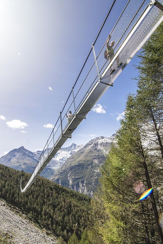 Low angle view of Worlds Longest Pedestrian Suspension Bridge during daytime, Randa, Wallis, Switzerland