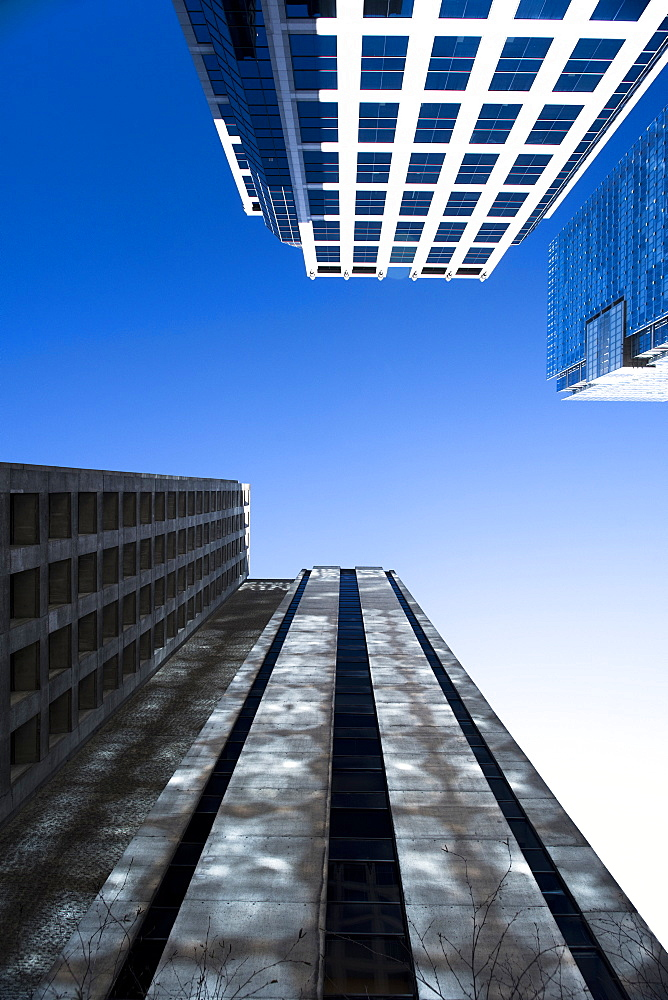 View from below of skyscrapers against clear sky in Vancouver, British Columbia, Canada
