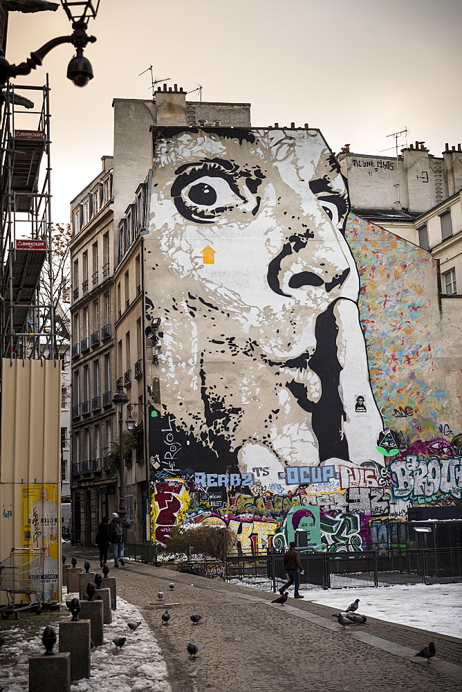 Mural of human face with finger on lips on wall of apartment block, The Marais, Paris - 857-95462