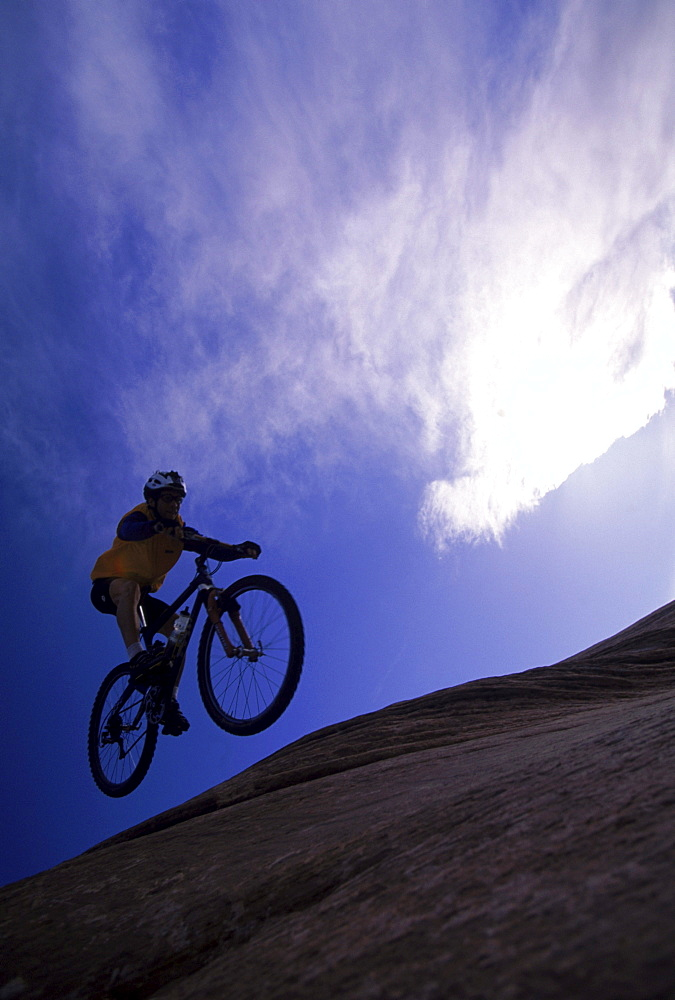 Dave Hartman airborne at the Halfpipe, Slickrock Bike Trail, Moab, UT.