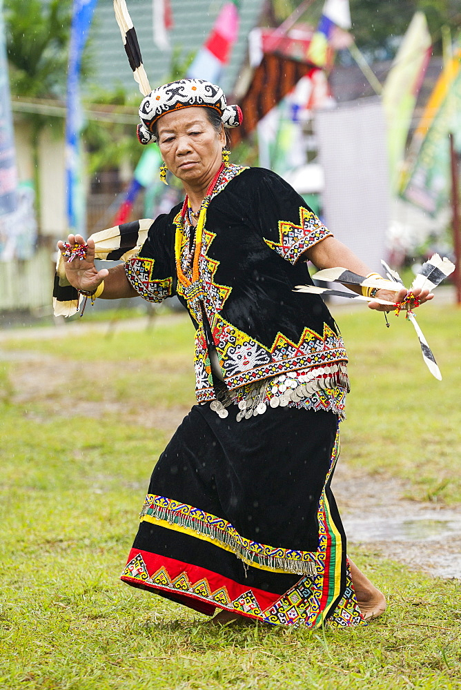 Woman wearing feather hornbill - Dayak Parade Indonesia