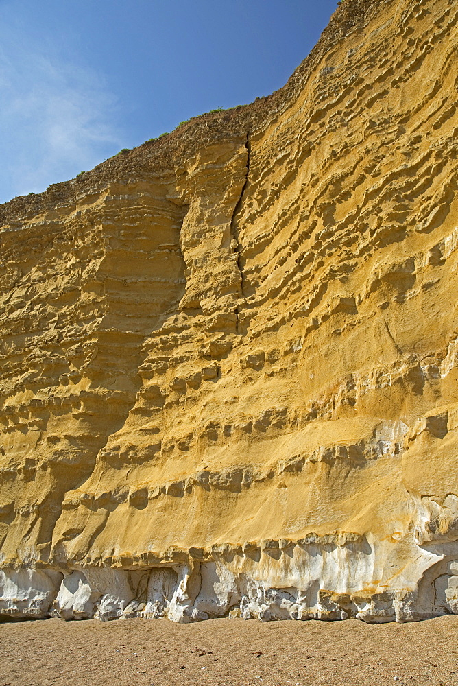 Iconic golden cliffs West Bay and Hive Beach Burton Bradstock Jurassic Coast, Dorset, UK