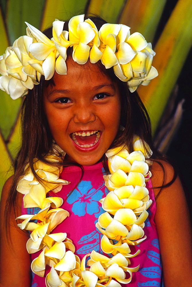 young Hawaiian girl wearing a flower lei Maui Hawaii USA