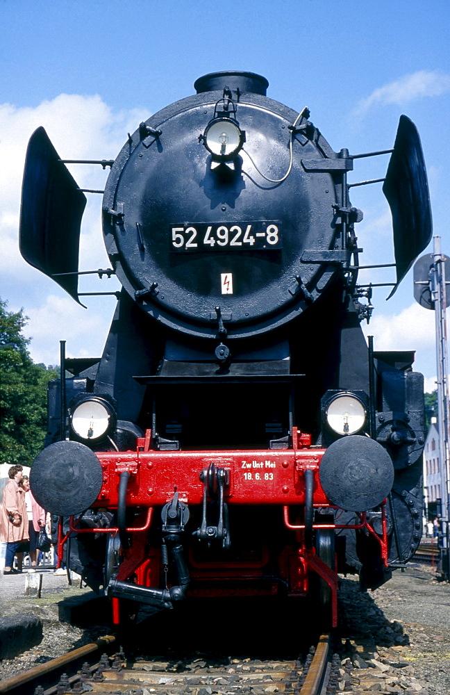 historical steam locomotive typ 52 4924-8 on rails in rail station Annaberg-Buchholz Sachsen Deutschland