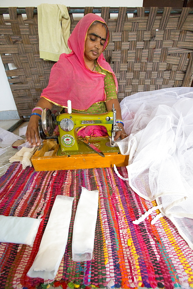 Disabled women swing garments at the Barefoot College in Tilonia, Rajasthan, India. The Barefoot College is a worldwide charity, founded by Bunker Roy, its aims are, education, drinking water, electrification through solar power, skill development, health, women empowerment and the upliftment of rural people.