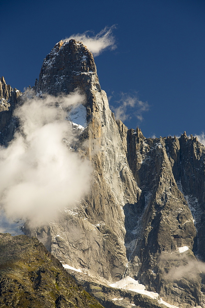 The Drus, a famous rock wall on the Mont blanc range. The pale grey area of rock upper rightis new rock revealed by a recent, massive rock fall.