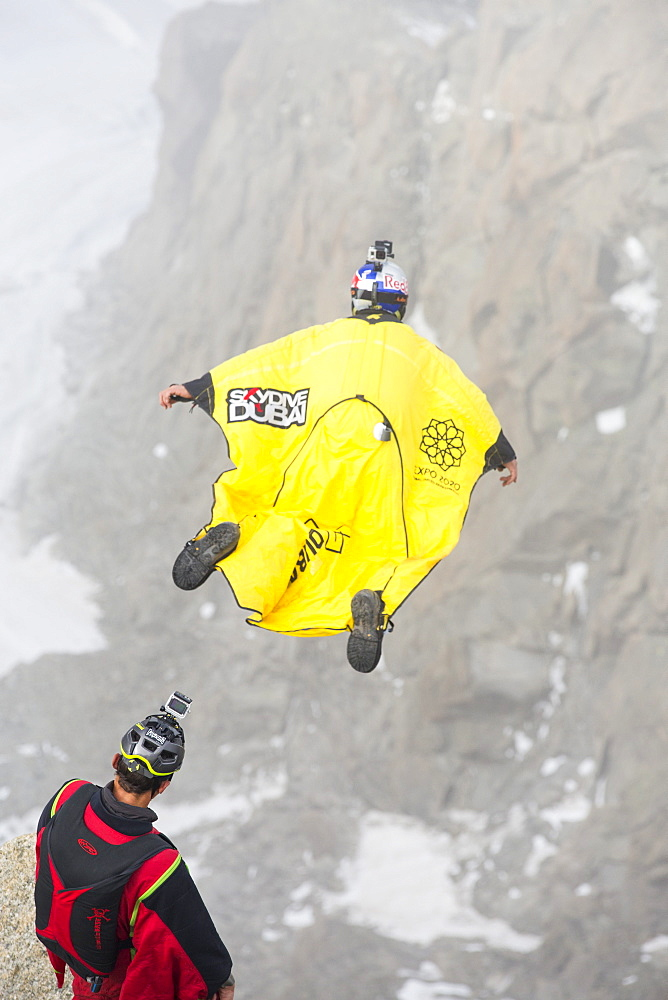 Base jumpers wearing wing suites jump from the Aiguille Du midi above Chamonix, France.