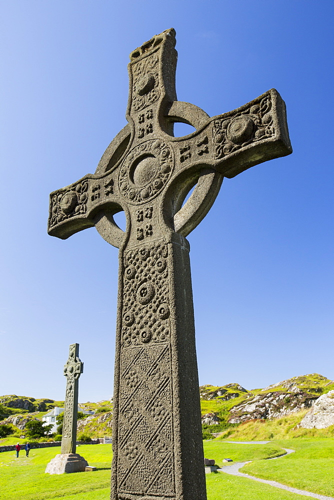 St john's Cross in the grounds of Iona Abbey, Iona, off mull, Scotland, UK, with St Oran's Cross in the background