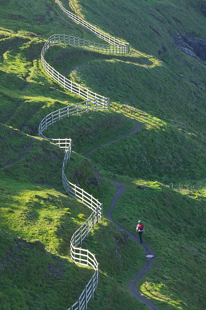 A winding fence and the South West Coast Path near Port Isaac in Cornwall, England, United Kingdom, Europe