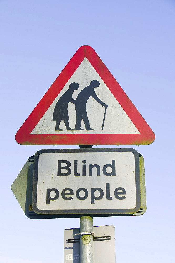 A warning for blind people crossing the road, Windermere, Cumbria, England, United Kingdom, Europe