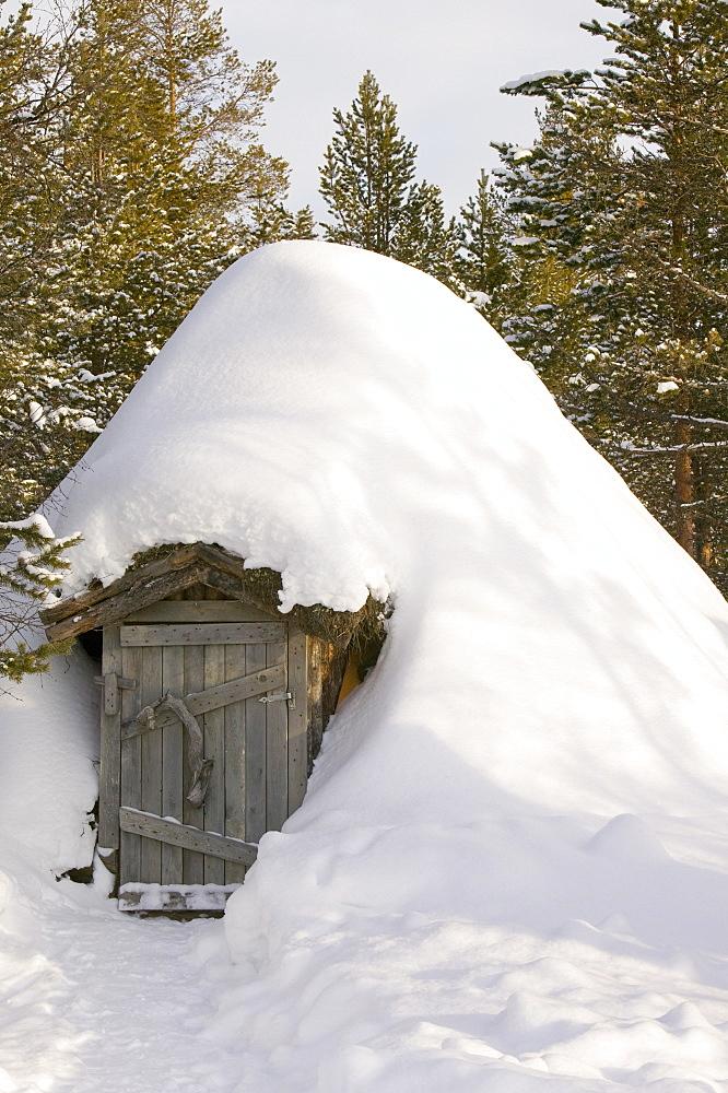 A traditional Sami house in winter in Saariselka, Northern Finland, Finland, Scandinavia, Europe