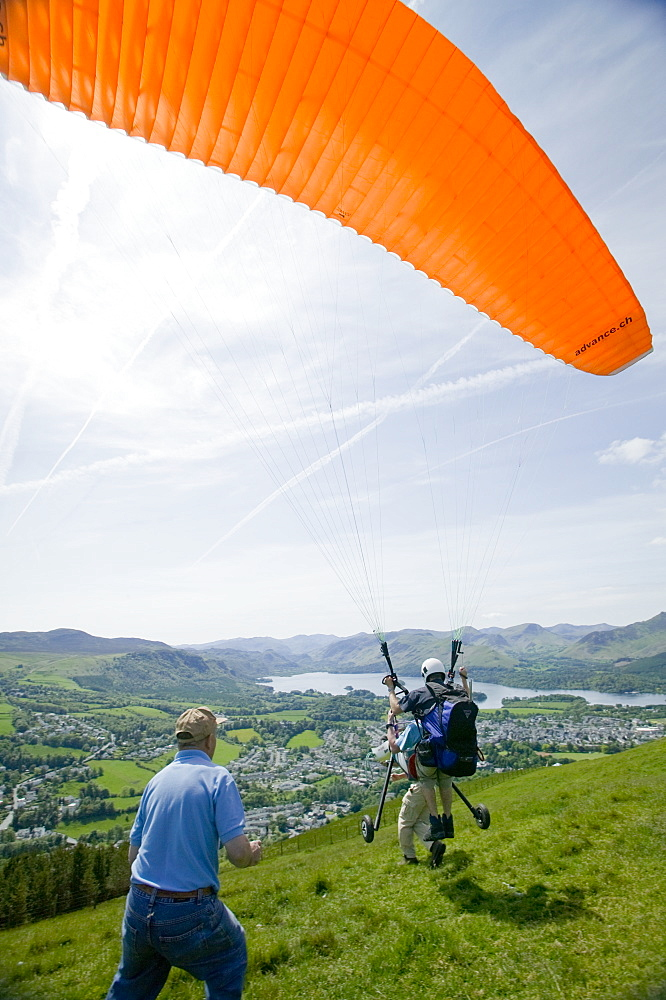 A wheelchair bound disabled person preparing to go parapont flying above Keswick, Lake District, Cumbria, England, United Kingdom, Europe