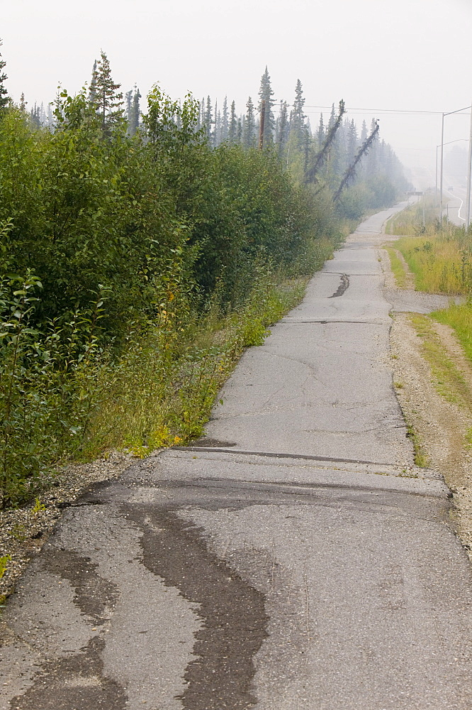 Pavement in Fairbanks collapsing into the ground due to global warming induced permafrost melt, Alaska, United States of America, North America