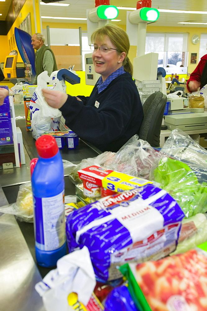 Food on a cash out conveyor belt in a Tesco supermarket in Carlisle, Cumbria, England, United Kingdom, Europe