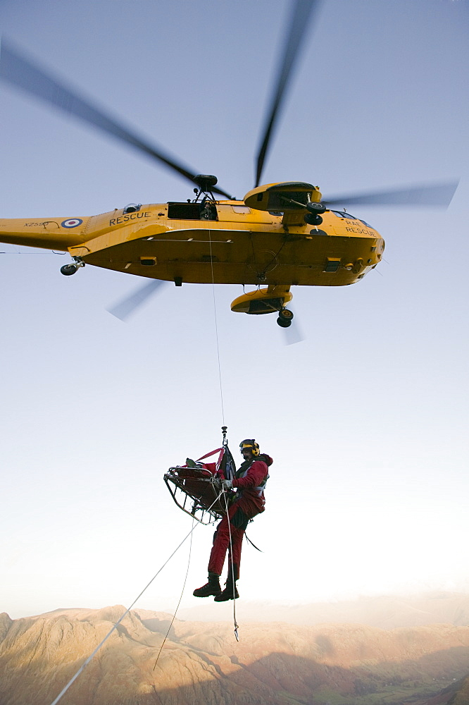 An RAF Sea King helicopter attends a mountain rescue incident in the Lake District, Cumbria, England, United Kingdom, Europe