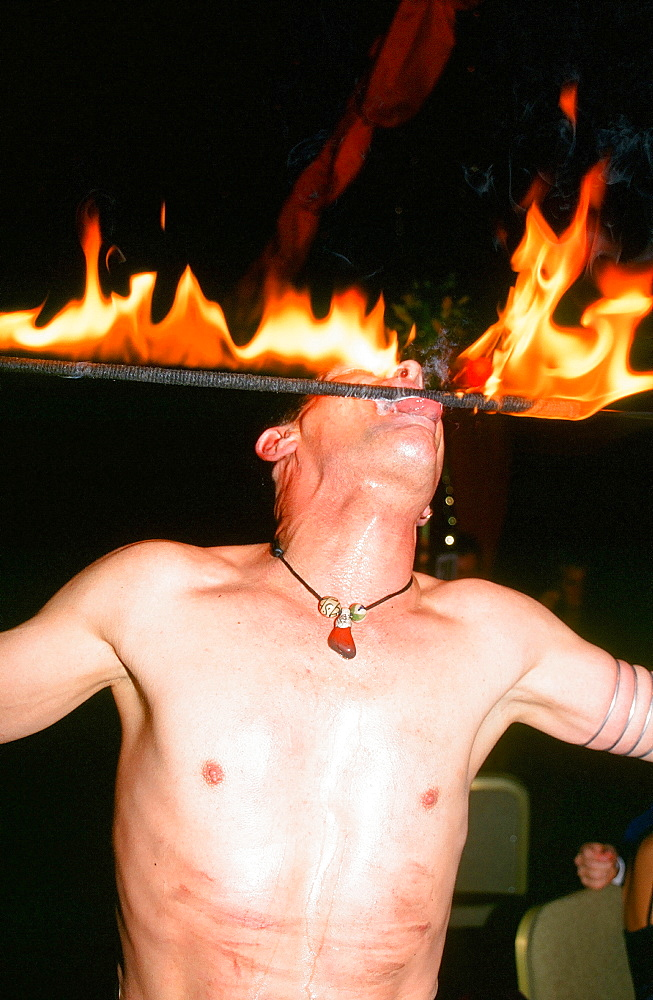 A performer doing his fire eating act